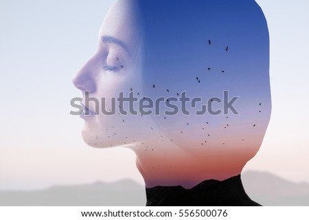 Double exposure photo with woman silhouette and sunset sky with mountains and birds. Freedom and travel concept