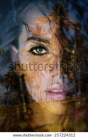 Double exposure photograph of attractive woman blended with image of palm tree
