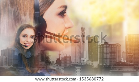 Double exposure Portrait female hotline operators, happy call center service, smiling,answering and telemarketing with hands-free headsets. Cheerful customer service: Work connect cityscape background