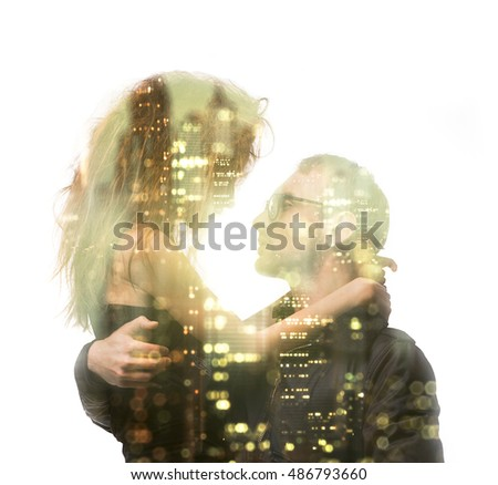Stock Photo Double exposure portrait of a couple looking at each other with passion, hugging. Combined with photograph of modern skyscraper in lights. Romance and people concept. Big city life