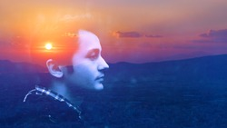 Double exposure portrait of a dreamy cute alone happy man face outdoors nature, sunrise or sunset cloud. closeup. Power of mind, brain memory inner voice concept. Fresh air yoga deep breath, live well