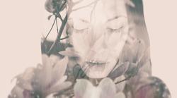 Double exposure portrait of a dreamy woman