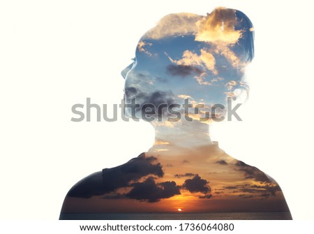 Double exposure portrait of a woman in contemplation at sunset time Foto stock ©