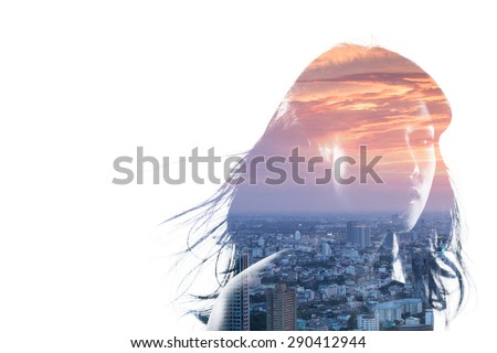 Double exposure portrait of an Asian woman and metropolitan city at dusk