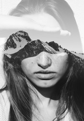 Double exposure portrait of attractive girl combined with photograph of snowy mountain