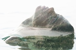Double exposure portrait of attractive woman combined with photograph of lake surrounded by mountains