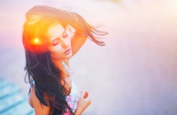 Double exposure portrait of free calm woman outdoors with eyes closed and sun hair on summer beach, nature sunrise or sunset. closeup. Psychology freedom power of mind concept. Deep breath yoga relax.