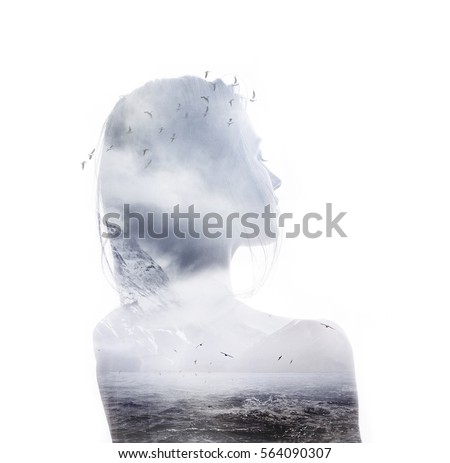 Double exposure portrait of young thoughtful woman combined with photograph of ocean with mountains and flying birds. Conceptual image showing unity of human with nature. Ecology, freedom, environment