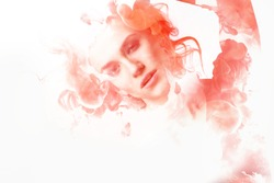 Double exposure portrait of young woman and cloud of red ink.