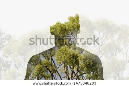 Double exposure silhouette head portrait of a thoughtful man combined with photograph of forest landscape. Ecology, freedom, environment Foto stock ©