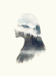 Double exposure silhouette head portrait of woman combined with photograph of mountains forest landscape. Conceptual image showing unity of human with nature. Ecology, freedom, environment. Isolated