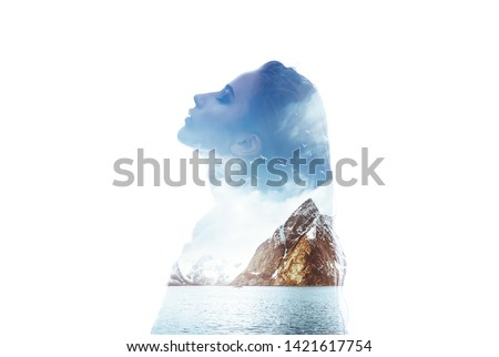 Double exposure silhouette head portrait of woman combined with photograph of mountains sea background. Conceptual image showing unity of human with nature. Ecology, freedom, environment. Isolated