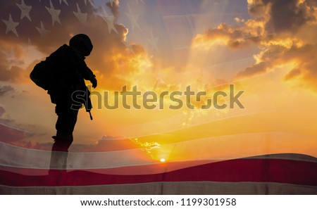 Double exposure Silhouette of Soldier on the United States flag in sunset for Veterans Day is an official USA public holiday background,copy space.