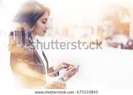 Double exposure successful female employer typing text message on her cellphone outdoor