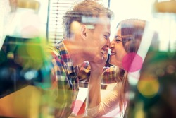 Double exposure with lovely romantic young couple enjoying and having fun in restaurant