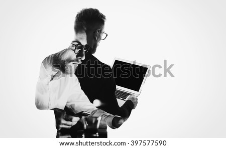 Double exposure young bearded  banker wearing black shirt and holding contemporary notebook hands.Blank screen ready for you message.Isolated white,portrait man background.Horizontal mockup