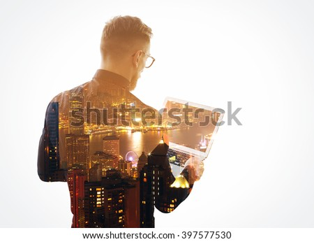 Double exposure  young bearded businessman wearing black shirt and holding contemporary notebook hands. Isolated white, night city background. Horizontal mockup