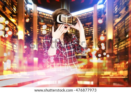 Double exposure, young girl getting experience VR headset, is using augmented reality glasses, being in a virtual actuality. In the library Stock photo ©
