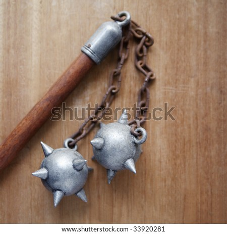 double flail on wood background