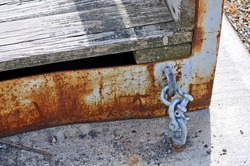 double galvanized marine shackles connecting dock ramp to cement pad