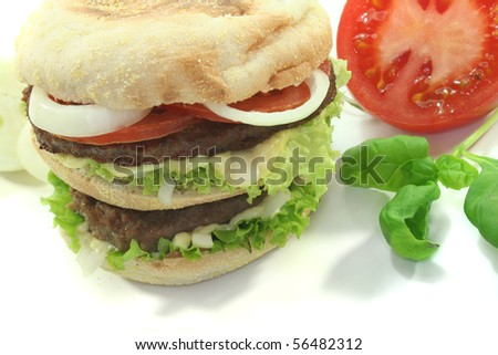 Double Hamburger with fresh vegetables and basil