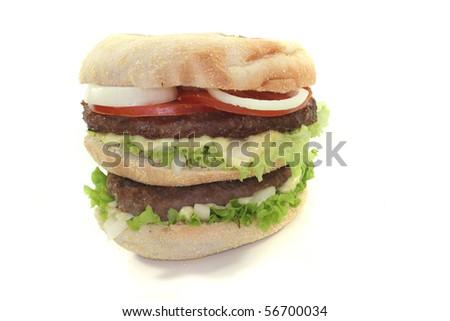 double hamburger with fresh vegetables on white background
