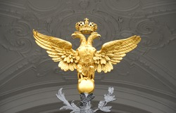 Double-headed eagle - the emblem of the Russian Empire at the gate of the State Hermitage in St.Petersburg, Russia.