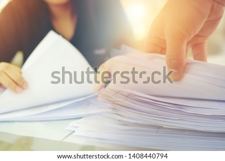 Double image office workers holding are arranging documents of unfinished documents on office desk, Stack of business paper. #1408440794