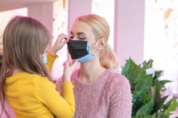 double mask on the face. A woman wearing two medical masks at the same time, blue and blue