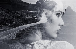 Double Multiple exposure image. Portrait of woman beautiful side profile view face combined with winding mountain road, coastline, Mediterranean Sea waters. Black and white creative photography photo