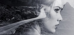 Double Multiple exposure image. Portrait woman beautiful side profile view face combined with winding mountain road, rocky coastline. Black and white toned creative photography