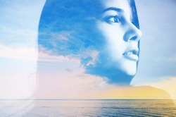 Double multiply exposure abstract portrait of a dreamy cute young woman head silhouette in clouds and sky, sunrise or sunset nature. Psychology power of mind, human spirit, mental health, zen concept