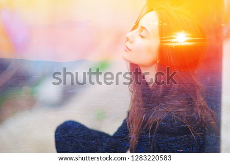 Double multiply exposure portrait of a dreamy cute woman meditating outdoors with eyes closed, combined photograph of nature, sunrise or sunset. closeup. Psychology power of mind inner voice concept.