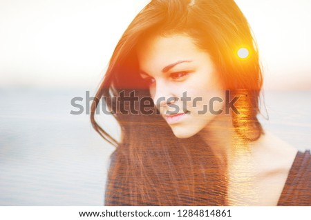 Double multiply face exposure portrait of a dreamy cute beautiful smart woman outdoors combined with photograph of day nature, sunrise or sunset closeup. Power of mind brain god pray soul hope concept