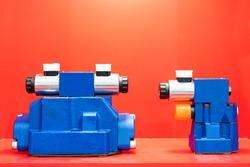 Double or dual and single coil solenoid hydraulic valve actuated and pilot operated on table