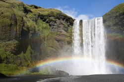 Double rainbow at the waterfall Skogafoss in Iceland
