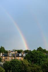 Double Rainbow on Blue Sky after Rain with building in Edinburgh.