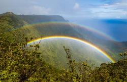 Double rainbow over Kalalau valley, seen from Pihea trail, Kauai, Hawaii. Shoot through a polarizer filter.