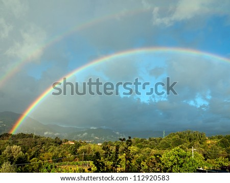 Double rainbow over Lunigiana hills, Italy