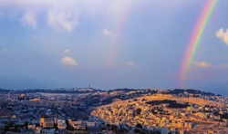 Double rainbow over Mount of Olives, with panoramic view from the Old city with Dome of the Rock on Temple Mount, Mount Scopus, the churches of Ascension to the arab villages in the Kidron valley