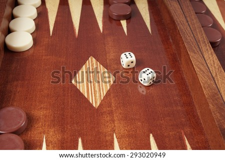double six or boxcars, rolling dice on backgammon board game