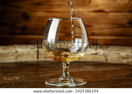 Double whiskey being poured into a glass  #1429386194