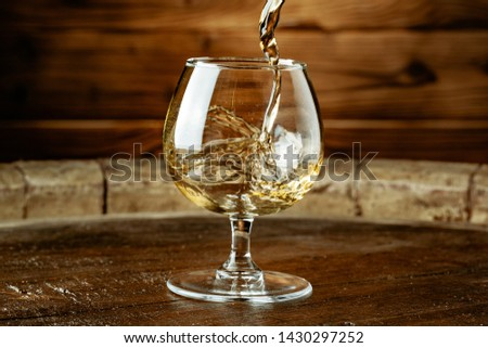 Double whiskey being poured into a glass  #1430297252