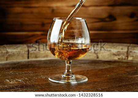 Double whiskey being poured into a glass  #1432328516