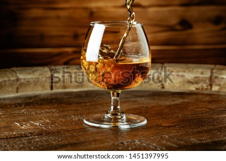 Double whiskey being poured into a glass  #1451397995