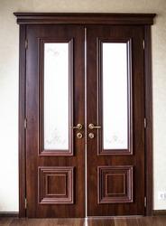 Double wooden interior door. The door to the room.