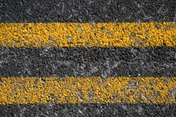 Double Yellow Line On Old Asphalt Road texture and background