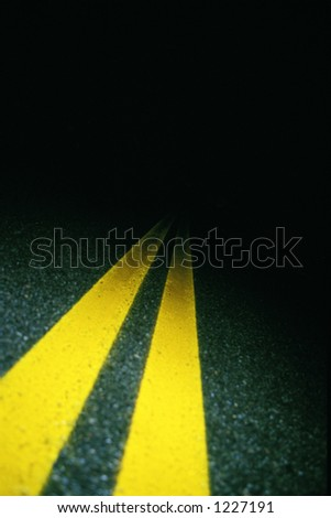 Double yellow lines on road at night