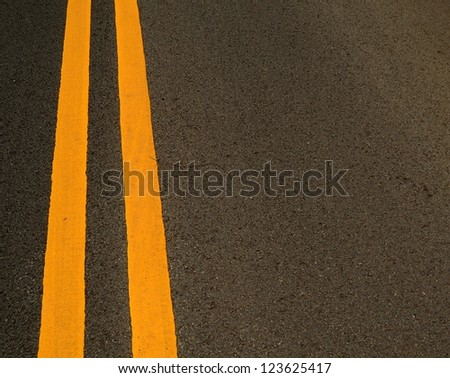 Double Yellow Marking Lines On A Road With Copy Space