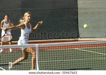 stock photo : Doubles tennis Player Hitting tennis ball with Backhand